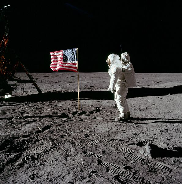 Buzz Aldrin salutes the American Flag
